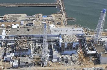 damaged Unit 3, left, and Unit 4 of the crippled Fukushima Dai-ichi.jpg